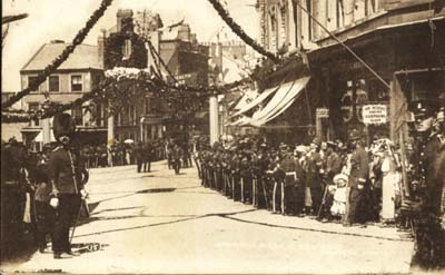 Crowds line the route at Bridge Street & Turf Square. © T. M. Hughes
