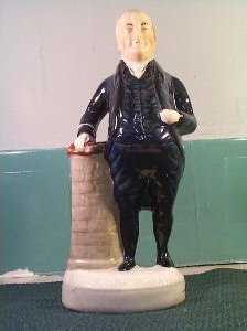 A Staffordshire figure of the Rev. John Bryan, who also had a Grocer's shop in Castle Street